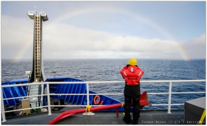 On the bow with a rainbow. Fair weather in the Arctic. Photo credit: Thomas Moore