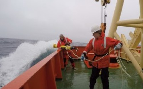 The ship's marine technician Mike and I deploying the first SOCCOM float in rough conditions in the Southern Ocean.
