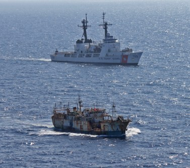 The crew of the Coast Guard CutterRushescorts the suspected high seas drift net fishing vesselDa Chengin the North Pacific Ocean on August 14, 2012. (Credit: U.S. Coast Guard)