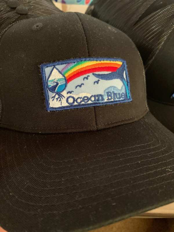 Ocean Blue Project logo rainbow hats handmade