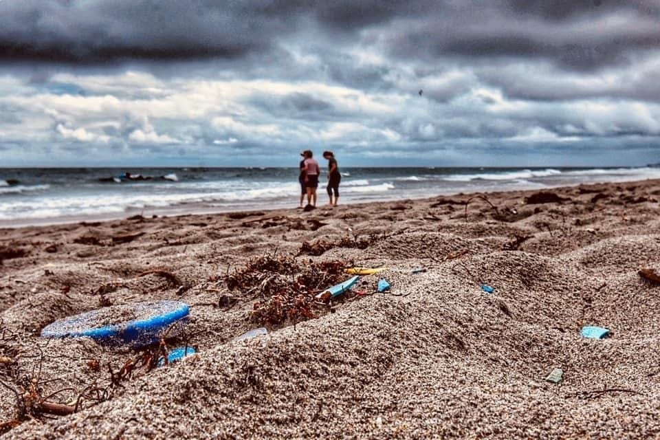 Plastic-washed-on-a-beach-by-waves-in-Miami-Beach-Florida