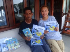 Aboard vessel Ombak Putih, Sea Trek Sailing Adventures. Maga, a local 'Trash Hero' and Anastasia a Tour Leaders from Ambon. She and Sea Trek's other tour leaders talk with the students and teachers when distributing the books to the Villages along their routes.