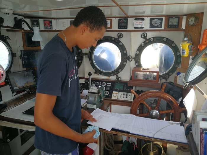Kilian cleaning the wheelhouse