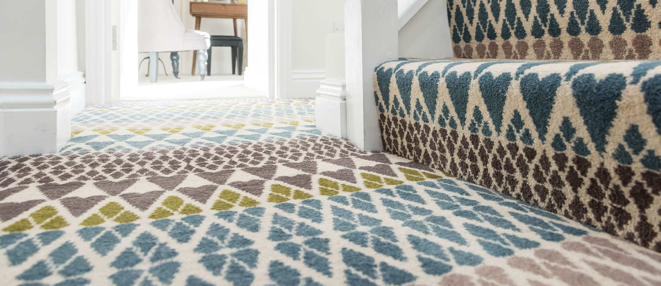 Why You Can Never Fail With Carpet Ocean Flooring Brighton | Zig Zag Stair Carpet | Winding Staircase | Geometric | Metal Bar On Stair | Red | Traditional