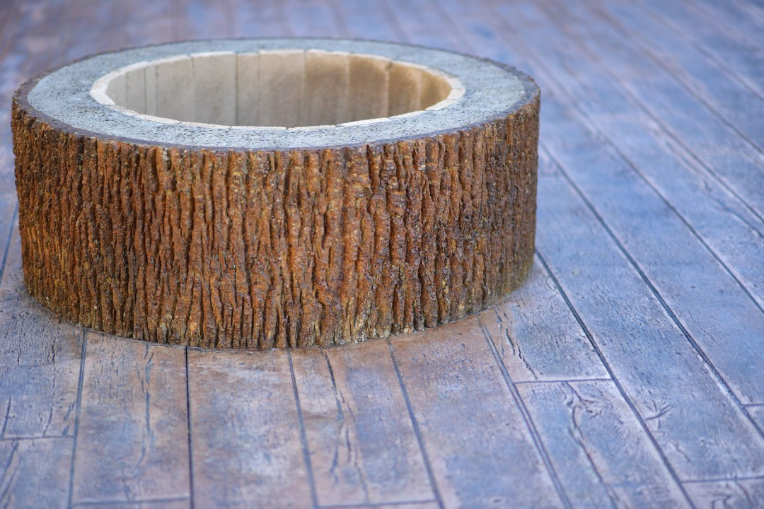 Heavy bark fire pit decorative concrete oregon contractor reclaimed lumber concrete stamp.