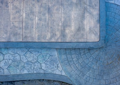 Artistic Concrete Stamping Wood Planks & Field Stone with Cobblestone and Borders.