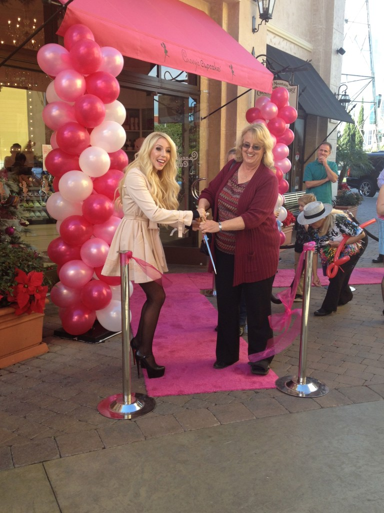 Owner of Casey's Cupcakes Casey Reinhardt with Huntington Beach Mayor Connie Boardman at the opening of the company's sixth store at the Bella Terra Shopping Center.
