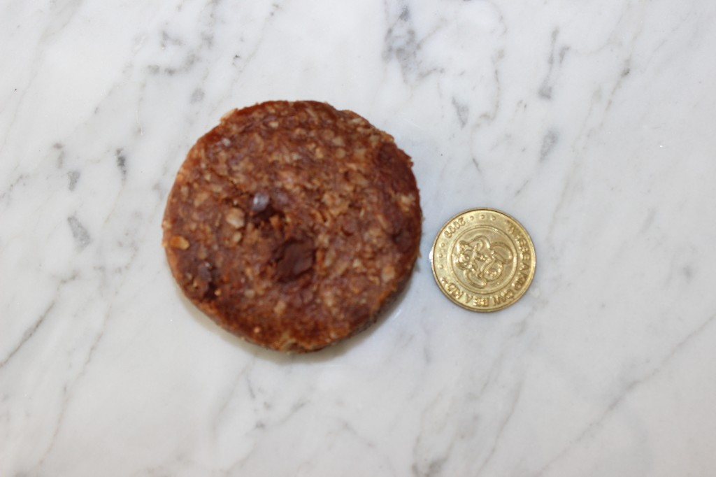 compare to a quarter sized coin