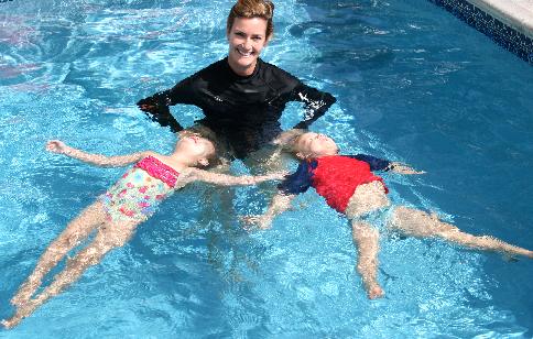 Owner OC Lil' Swimmers Michelle Coulston with her lil' students. Photo Courtesy OC Lil' Swimmers.