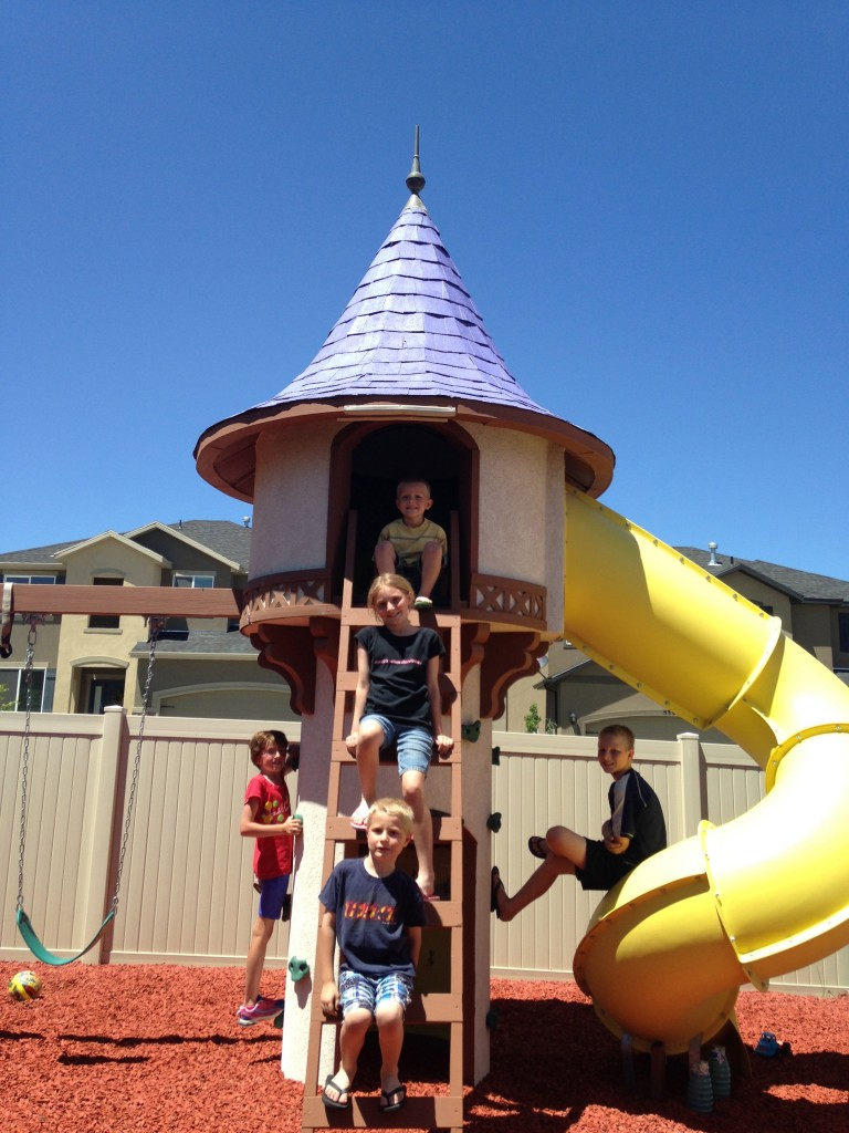 The kids enjoying the Tangled Tower in the backyard of the UP House