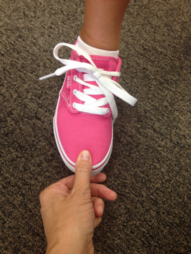 Checking the fit of my youngest daughter's shoe.