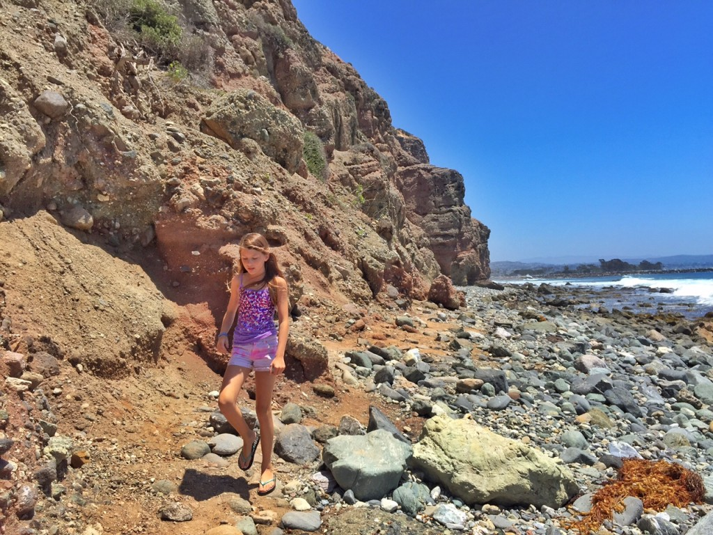 Climbing rocks in Dana Point
