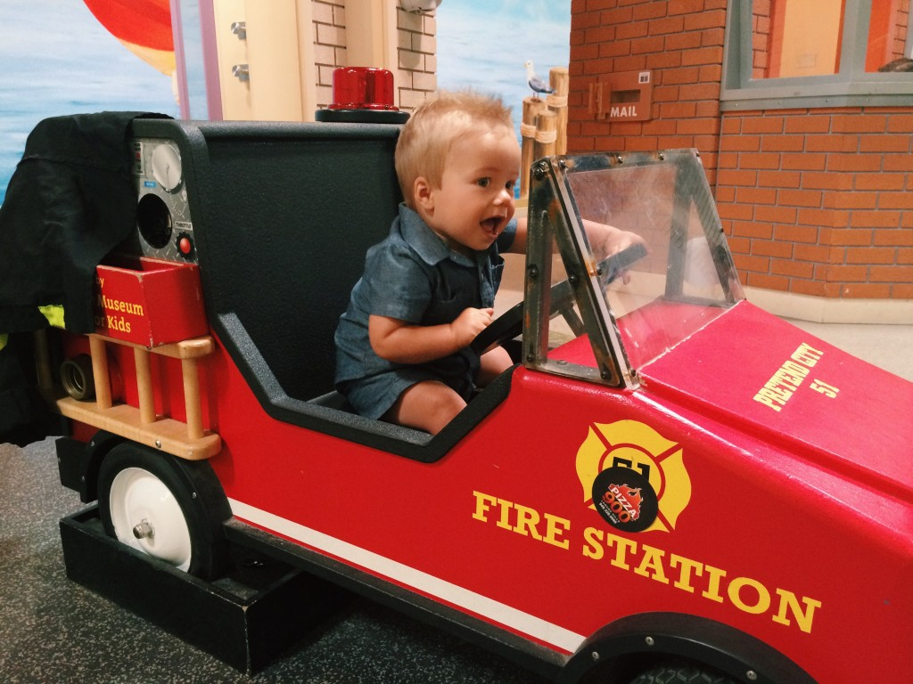 Riding a fire engine at Pretend City Children's Museum