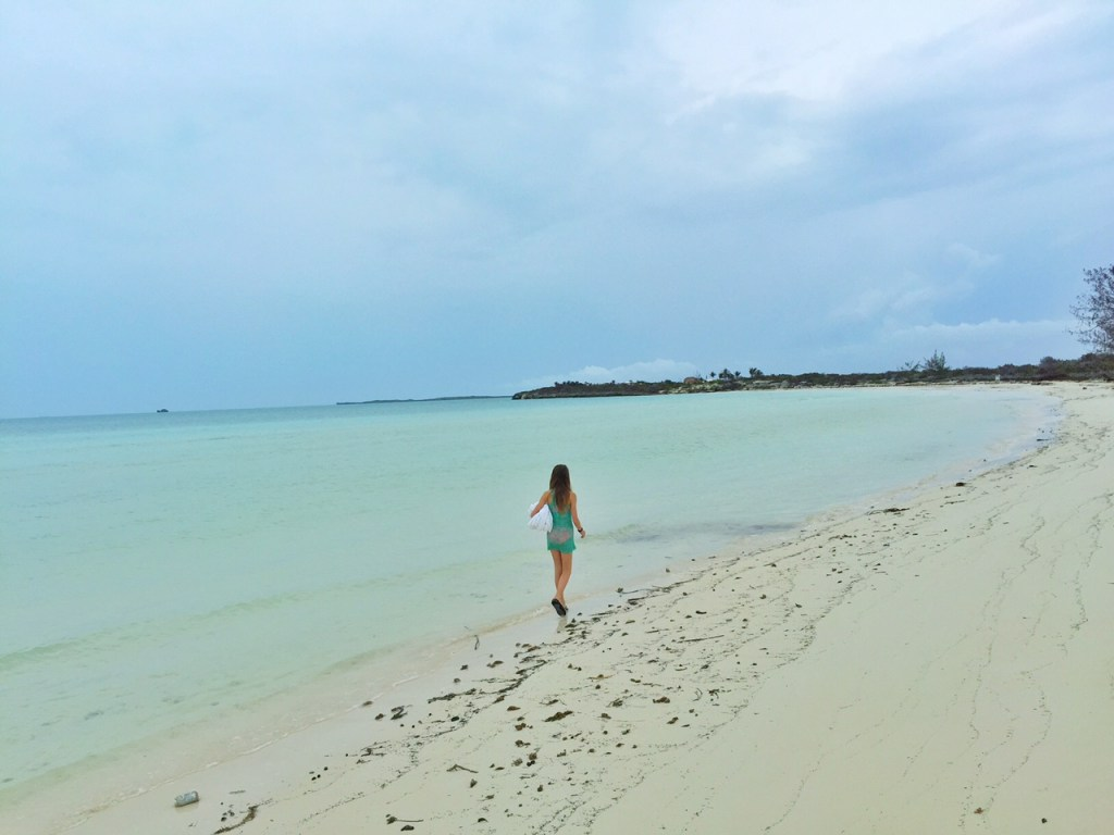 Kiddo walking on the beach in the Turks and Caicos