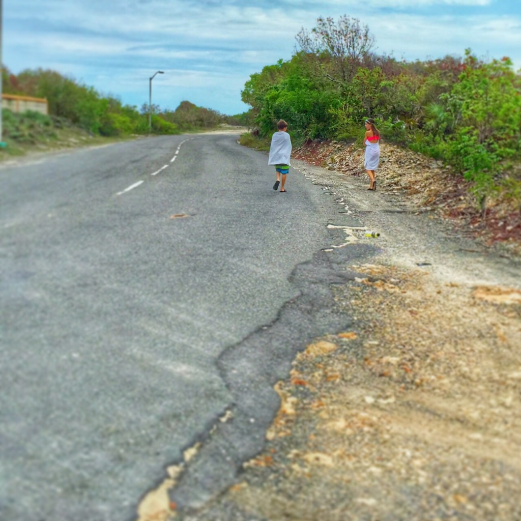 Kids walking along the street in the Turks and Caicos after playing at the beach