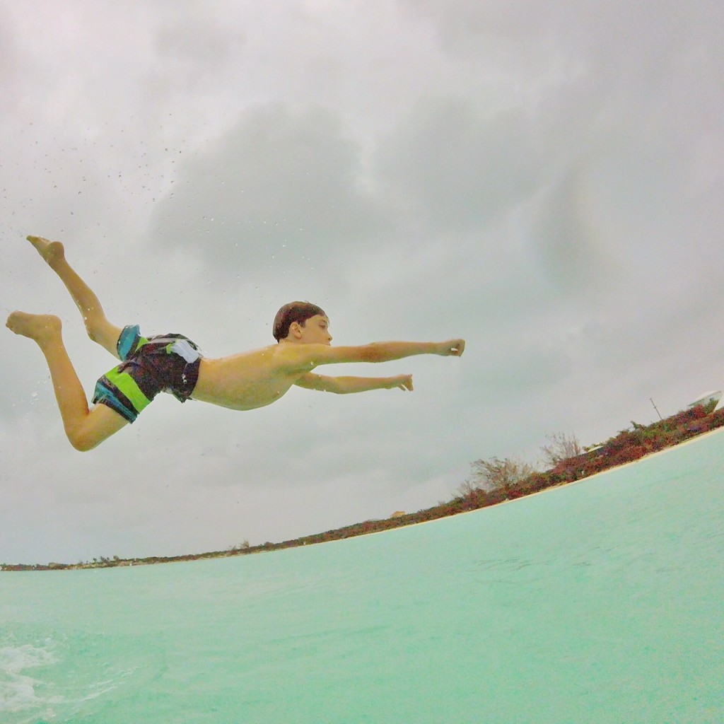 Kid flying over the waters in the Turks and Caicos