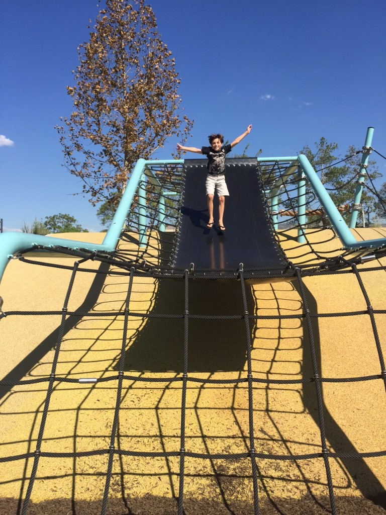 Jumping on a giant trampoline at Beacon Park in Irvine