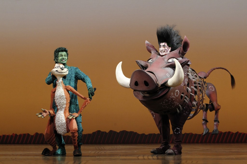 Pumbaa and Timon making the audience laugh during Lion King the Musical