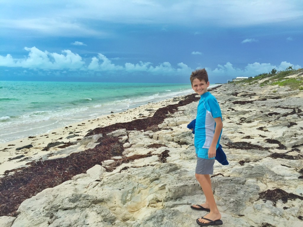 Andrew collecting shells at Long Bay Beach in the Turks and Caicos