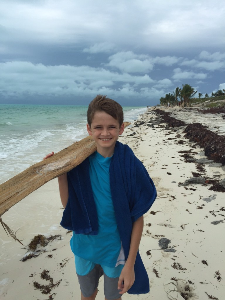Andrew collecting things on the beach at Long Bay Beach in the Turks and Caicos