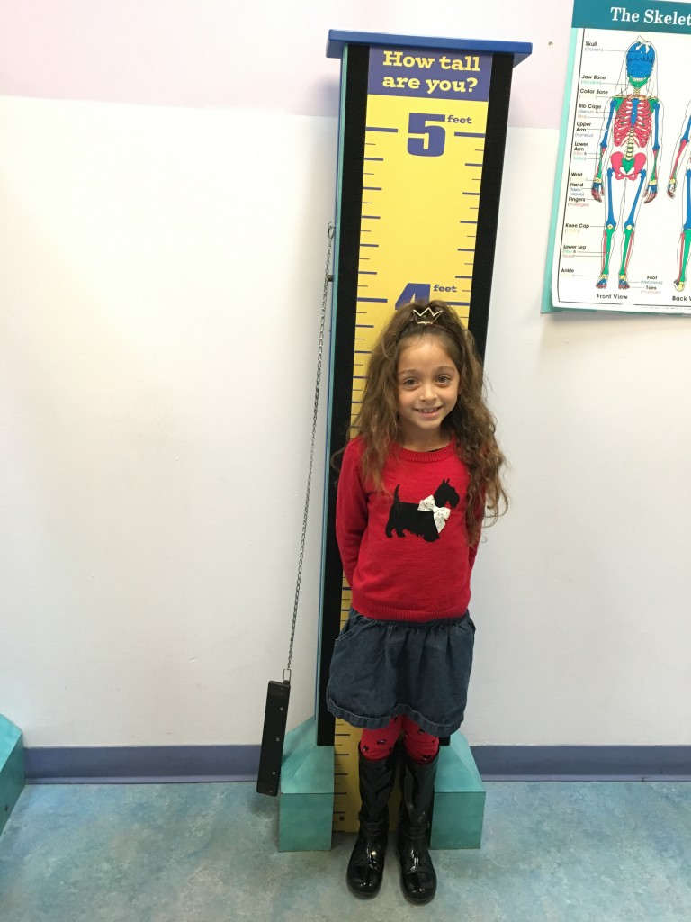 Child finding out how tall she is