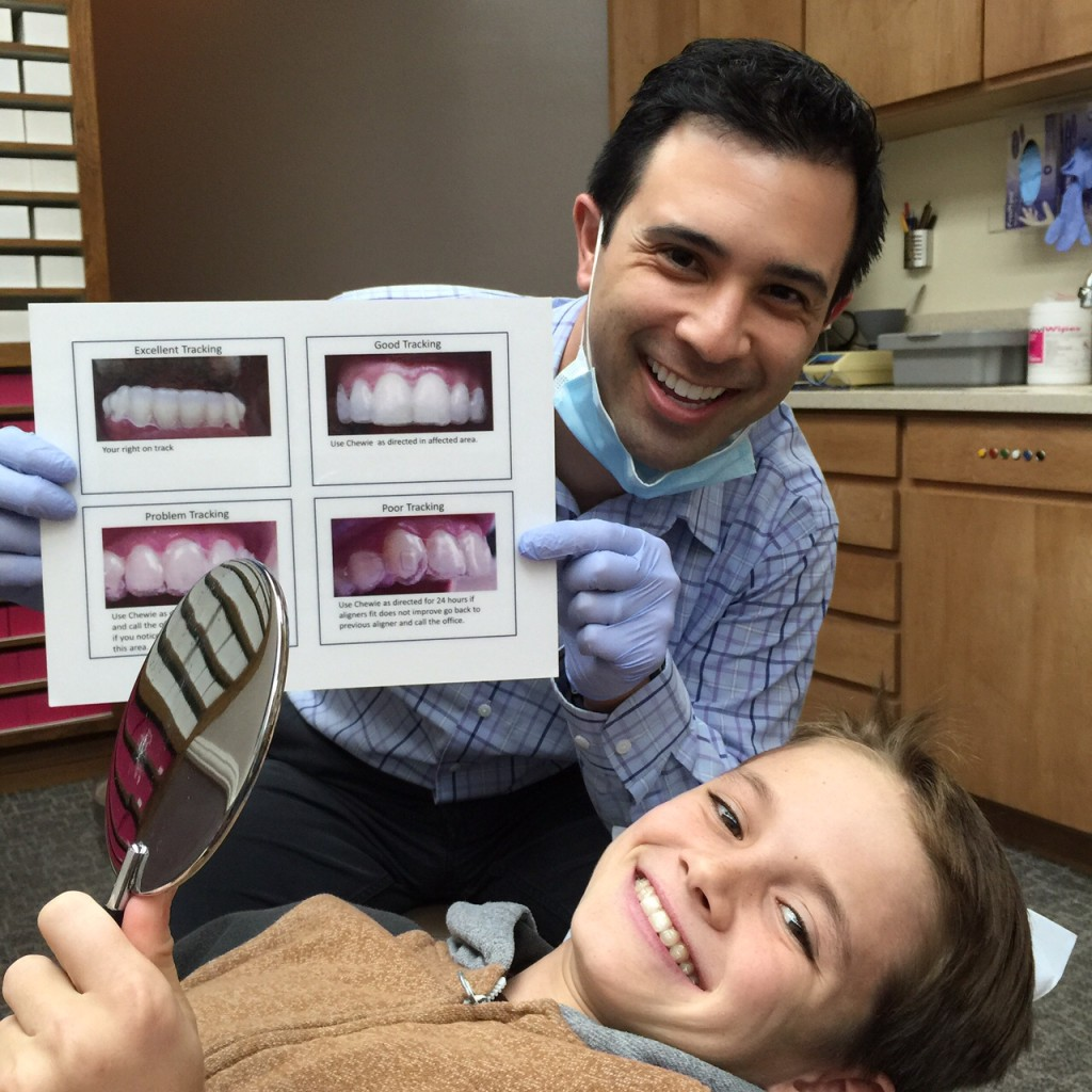 Dr. Passamano teaching and his Invisalign Patient