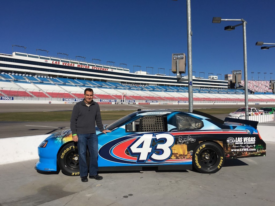 Houman in front of a Nascar Car in Las Vegas