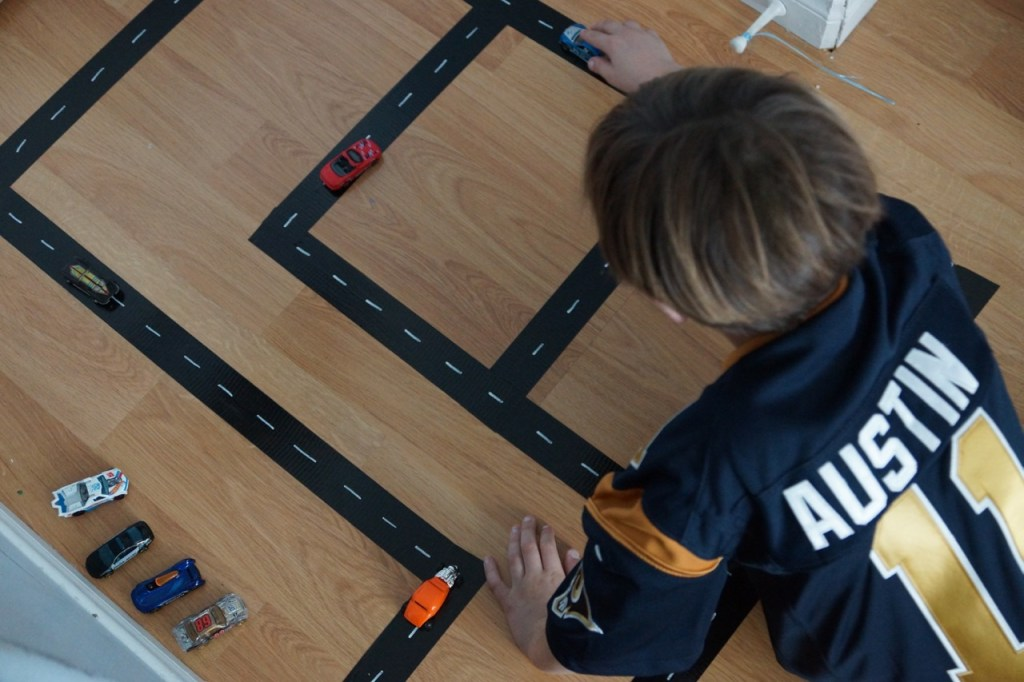 Kid Playing with DIY Hot Wheels Track
