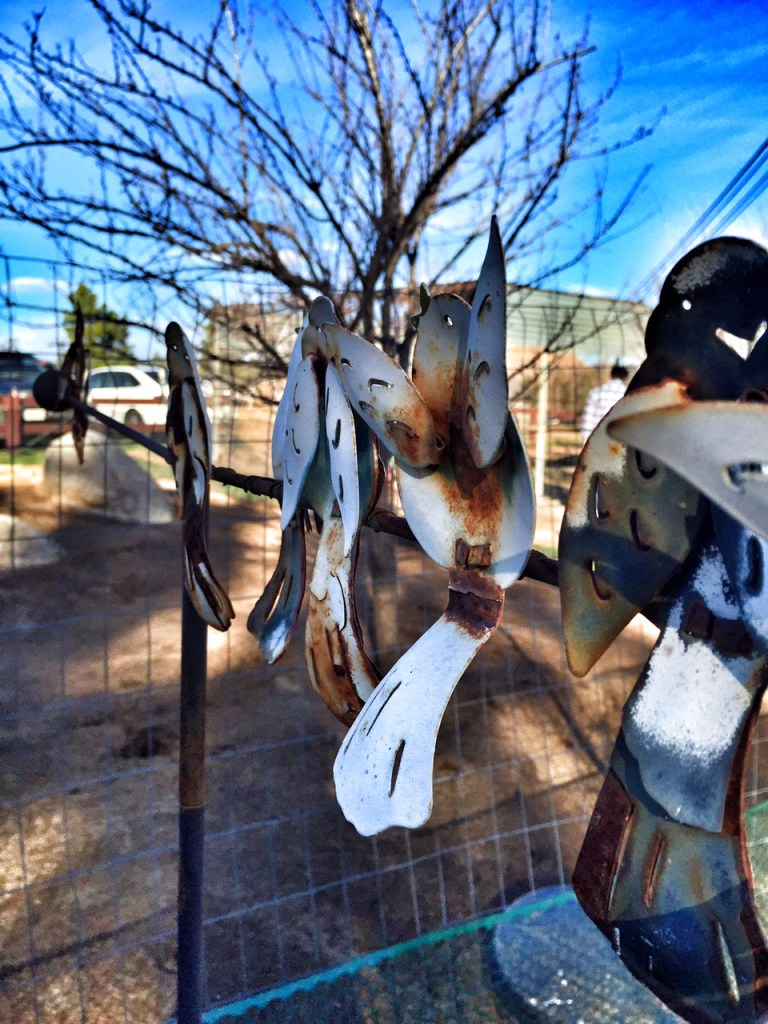 Metal birds at the farm