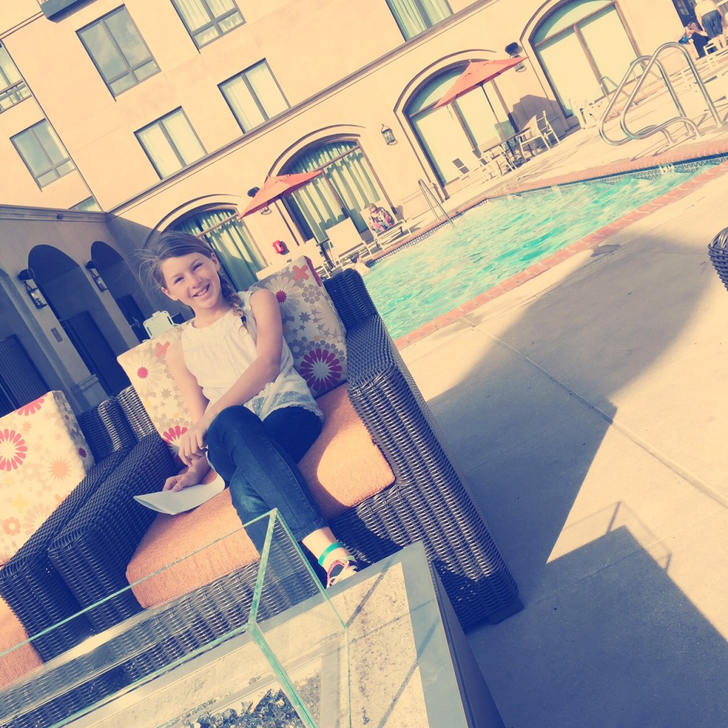 Relaxing by the pool of the Hilton Garden Inn