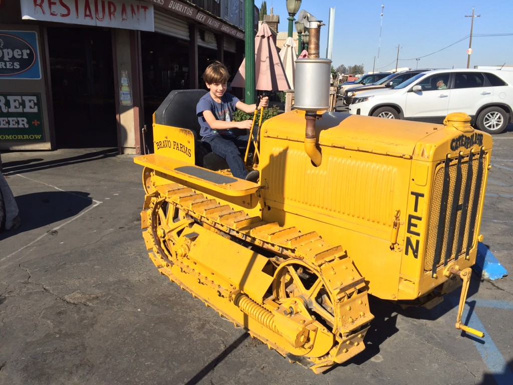Kid riding a tractor