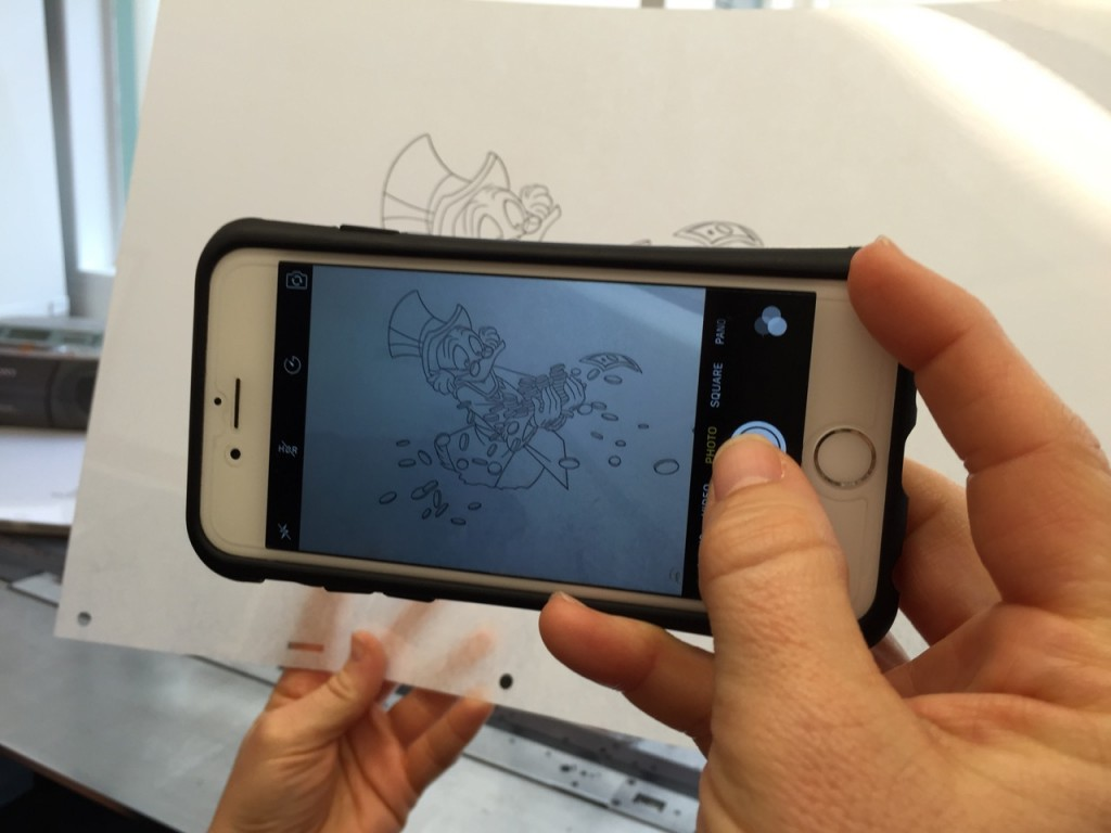 taking a picture of an animation cell
