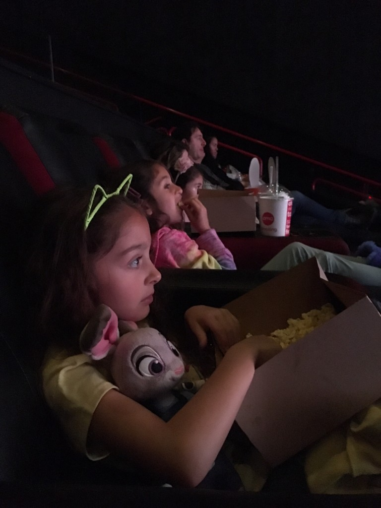 Kids watching a movie at AMC