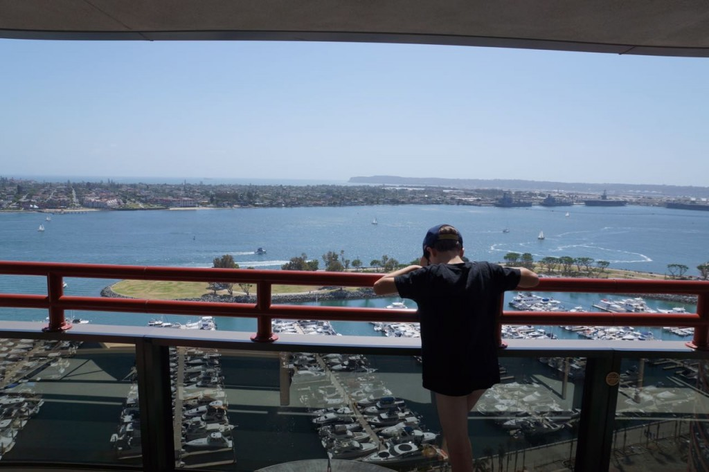 Kids looking at view from Marriott Marquis San Diego Marina room