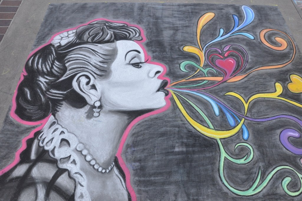 Lucy drawing at the Pasadena Chalk Festival
