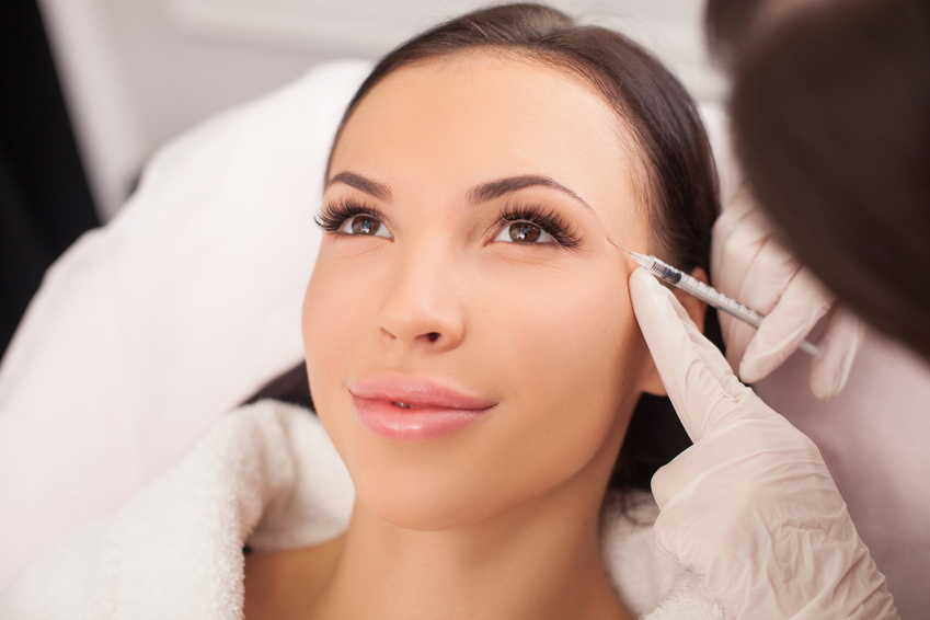 Attractive healthy lady is visiting expert beautician