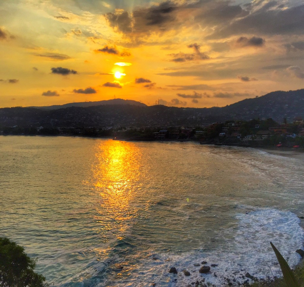 Sunset over the water in Zihuatanejo
