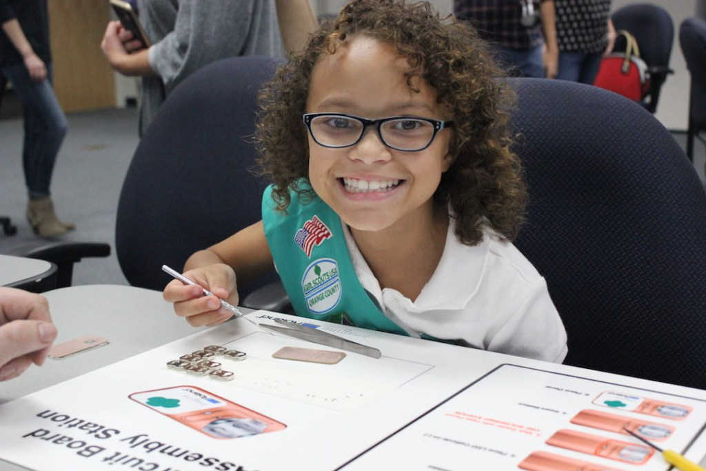 girl-scout-junior-working-on-her-stemsational-me-badge-by-creating-a-working-circuit-board-with-roland-dga