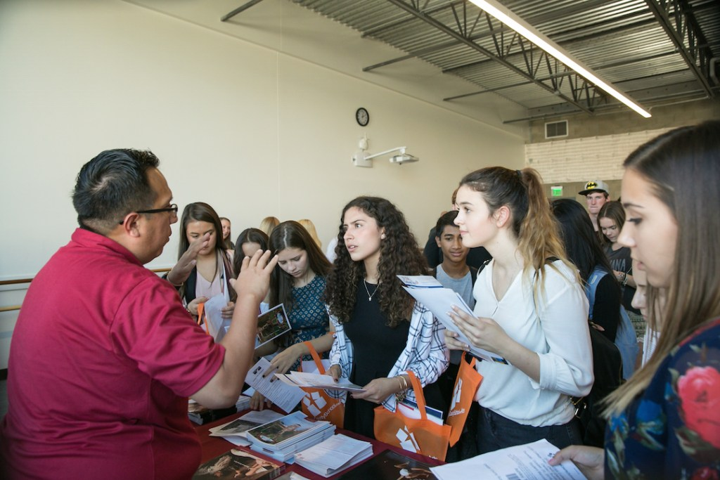 Kids getting college information at the OCSA College Fair