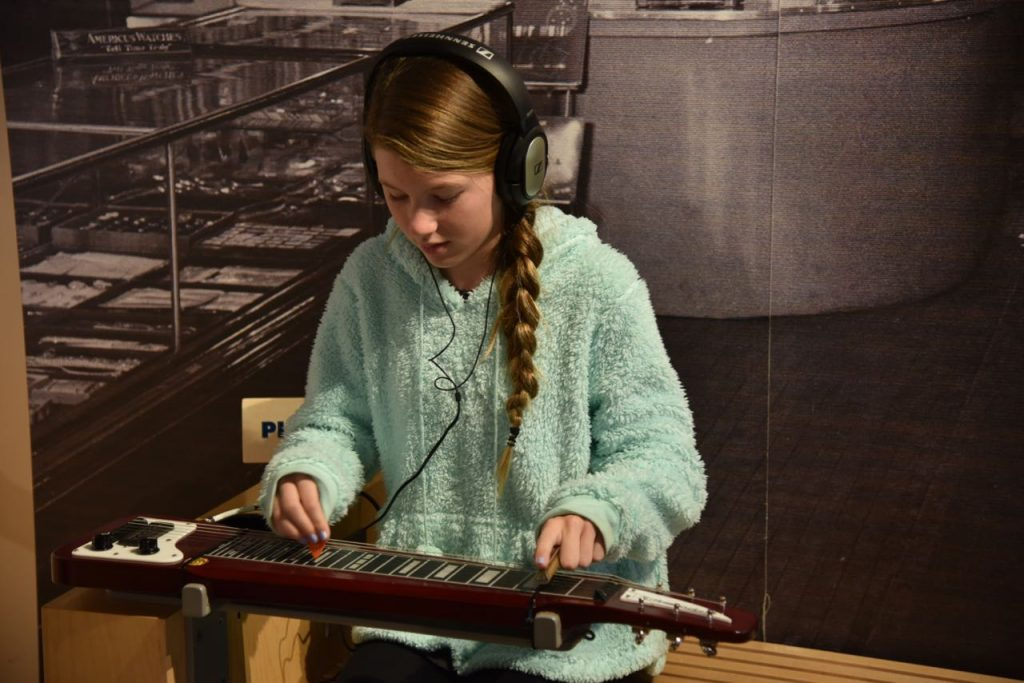 Playing an instrument at the Museum of Making Music