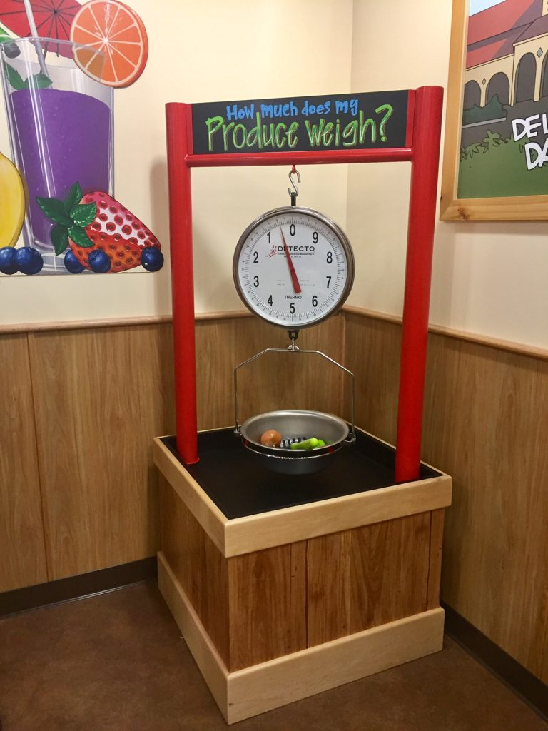 Weighing produce in the Pretend City Trader Joe's