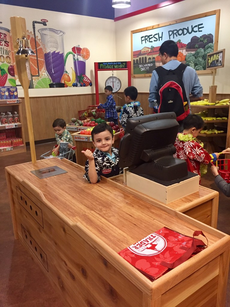Working the cash register at the Trader Joe's in Pretend City
