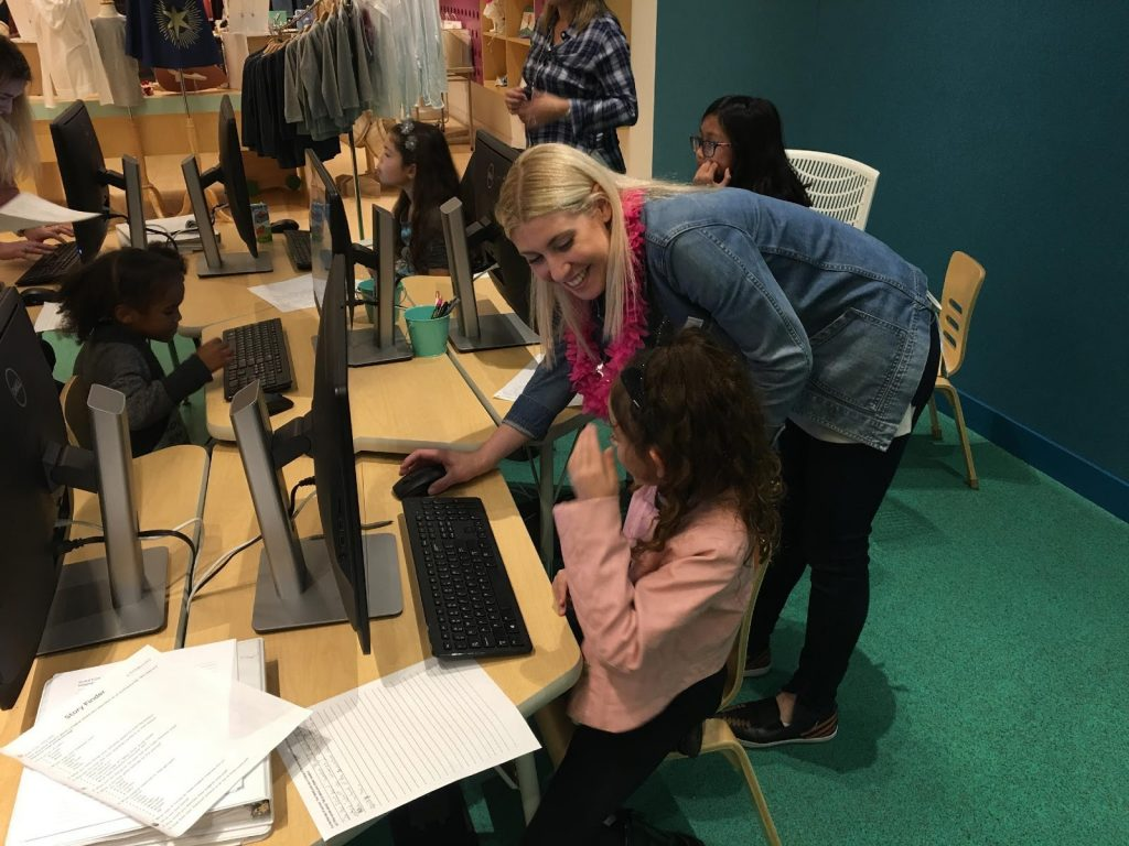 Helping children create a book at Storymakery in Irvine