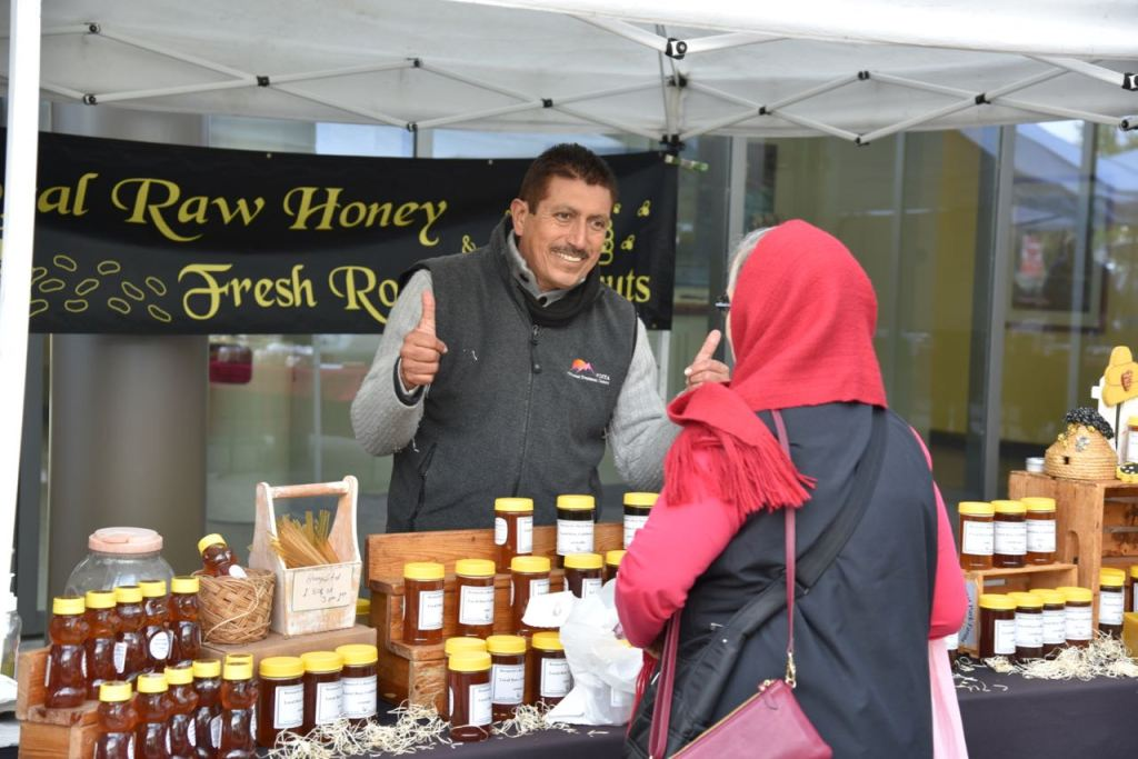 Purchasing honey at the Kaiser Permanente farmers market