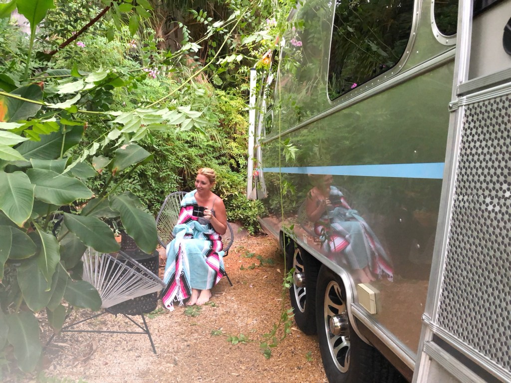 Enjoying coffee outside of an airstream at Caravan Outpost in Ojai