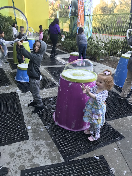 Kids playing with Bubbles at Bubblefest at Discovery Cube OC