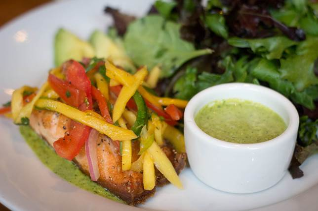 Grilled salmon with mango salsa with a small side salad and ginger cilantro sauce is a popular item on the lunch and dinner menu. Photo courtesy of PdM