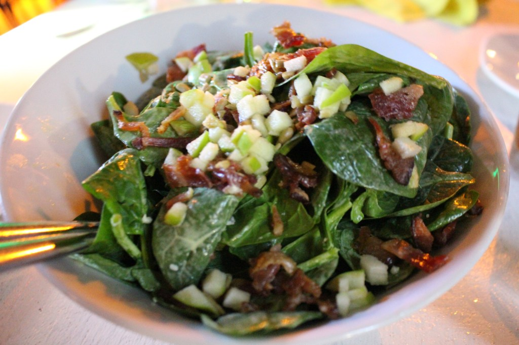 Spinach salad with diced green apple, bacon, crumbled bleu cheese and sunflower seeds with a light honey mustard dressing.