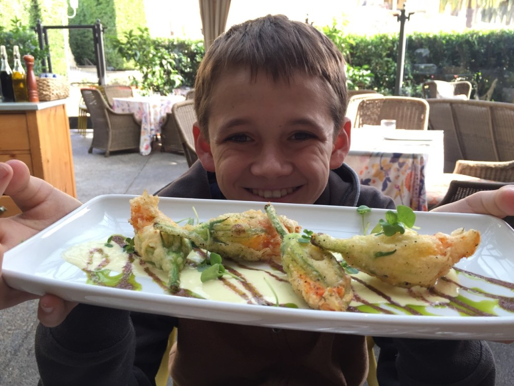Kid loving squash blossoms