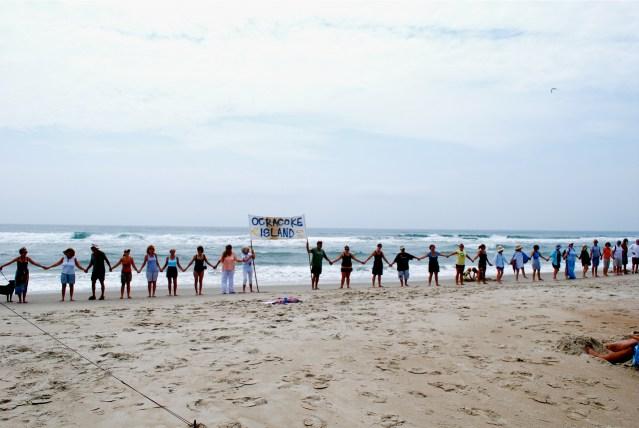 Hands across the sand. Photo Lou Ann Homan